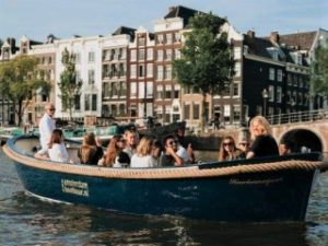 Private open boat canal tour Amsterdam Haarlemmerpoort