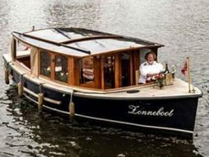 Boot mit Kapitän mieten Grachtentour Amsterdam
